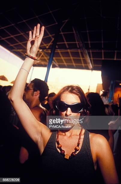 Woman raising arm to music, Space, Ibiza, 1999.
