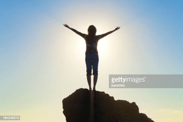 Woman Raising Arms In Hope