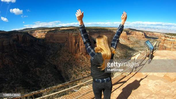 woman raising hands, national park usa - bluefootage stock pictures, royalty-free photos & images