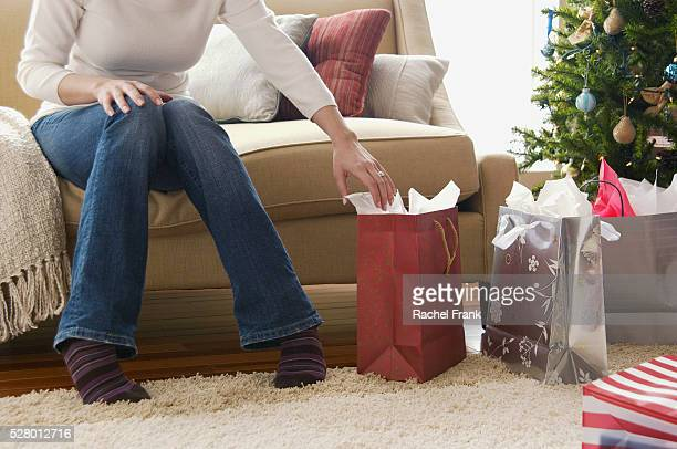 Woman reaching for a gift bag