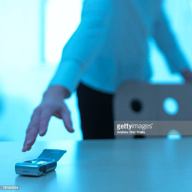Woman reaching for cell phone