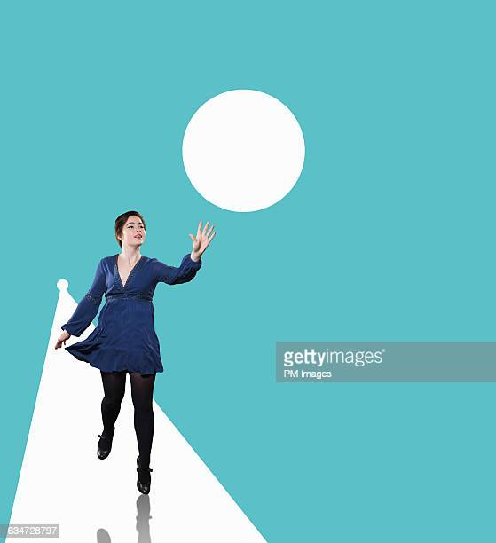 woman reaching for graphic ball - digital desire fotos stock-fotos und bilder