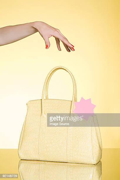 Woman reaching for handbag