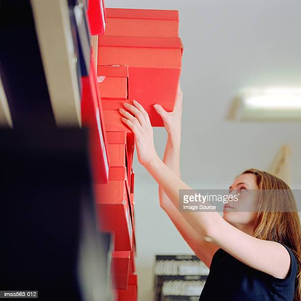 woman reaching for shoe box - shoe box stock pictures, royalty-free photos & images