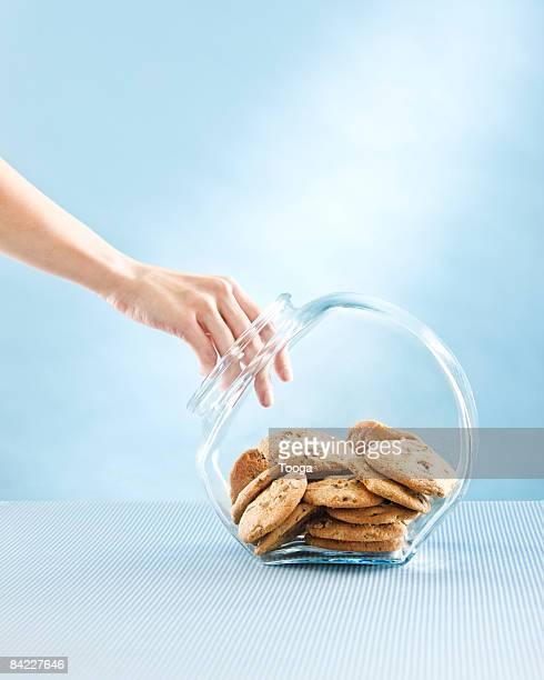 Woman reaching into cookie jar