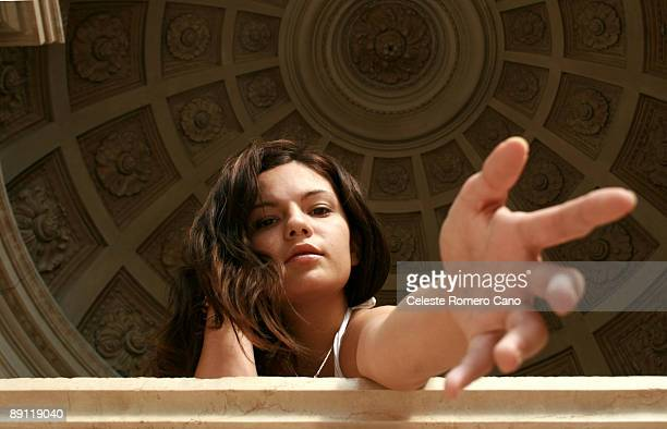 woman reaching out under a dome - 手を伸ばす ストックフォトと画像