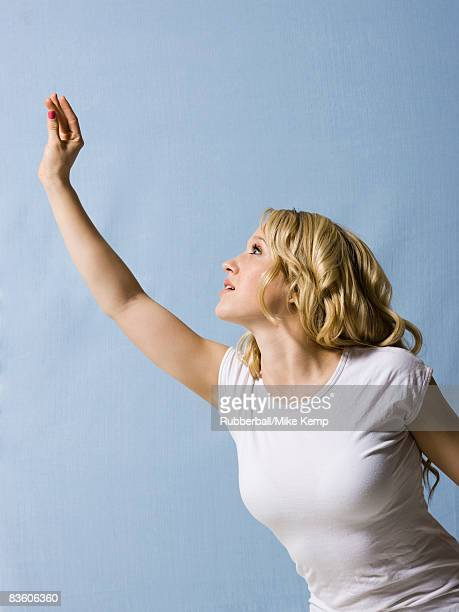 woman-reaching-up-to-camera