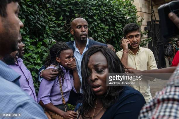 A woman reacts after being rescued from the Dusit Hotel on January 15 2018 in Nairobi Kenya A current security operation is underway after terrorists...