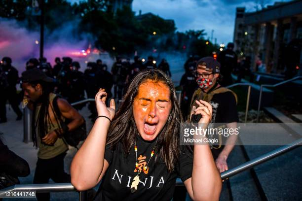 A woman reacts after being sprayed by pepper spray next to the Colorado State Capitol as protests against the death of George Floyd continue for a...