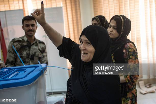 A woman reacts after casting her referendum vote at a voting station on September 25 2017 in Erbil Iraq Despite strong objection from neighboring...