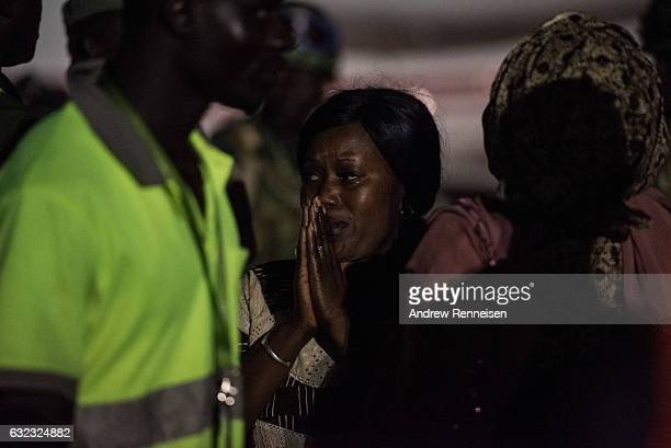 Woman reacts after Ex-President Yahyah Jammeh boarded a plane leaving the country on January 21, 2017 at Banjul International Airport in Banjul,...
