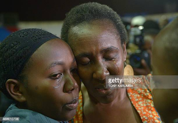 A woman reacts after she is reunited with her daughter in Niairobi on April 04 a survivor of an attack by islamist gunmen claimed by alShabab on a...