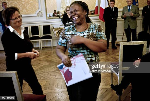 A woman reacts after she received her French naturalization documents during an official ceremony on November 5 2009 at Macon's prefecture central...