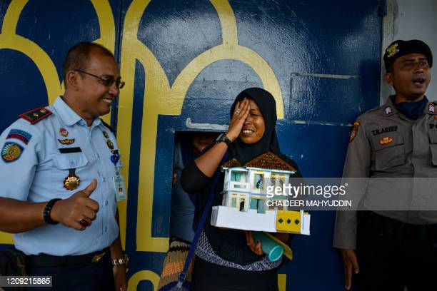 Woman reacts after she was released from prison, due to concerns of the spread of the COVID-19 coronavirus, in Lhoknga near Banda Aceh on April 6,...