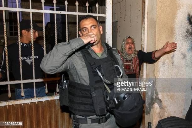 Woman reacts amid ongoing confrontations as Palestinian families face eviction in the Sheikh Jarrah neighbourhood of East Jerusalem, on May 4, 2021....