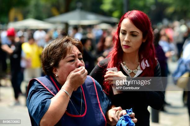 A woman reacts as a real quake rattles Mexico City on September 19 2017 moments after an earthquake drill was held in the capital A 71 magnitude...