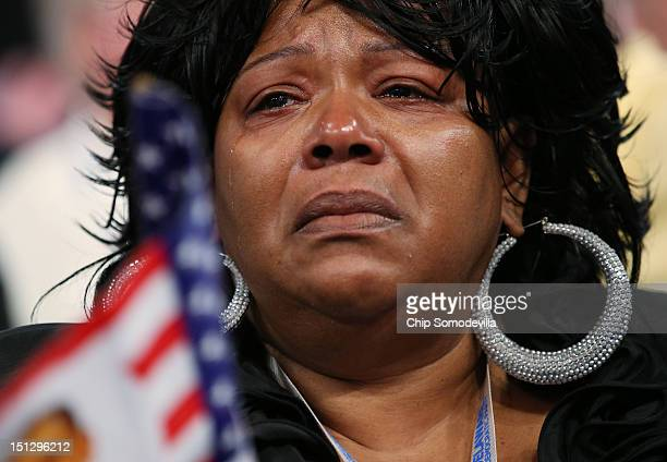 A woman reacts as Chair of the Congressional Black Caucus US Rep Emanuel Cleaver II speaks during day two of the Democratic National Convention at...