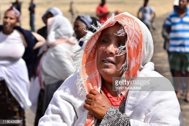 A woman reacts as distraught relatives of the victims visit the crash site of the Ethiopian Airlines operated Boeing 737 MAX aircraft at Hama...