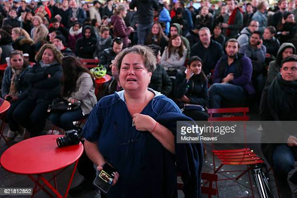 A woman reacts as Donald Trump wins Georgia in the presidental election outside Times Square on November 8 2016 in New York City Trump was leading...