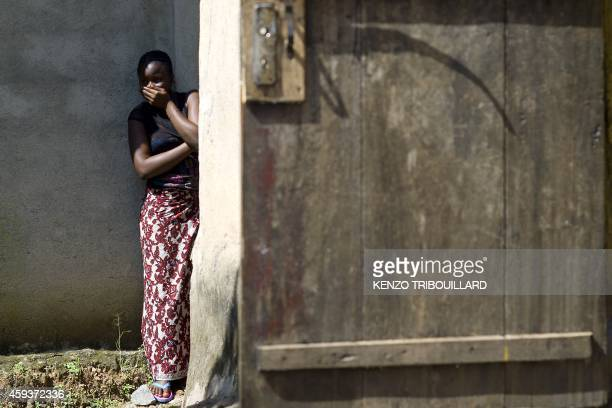 A woman reacts as Guinean Red Cross workers arrive to remove the corpse of a neighbour who died of Ebola in Macenta on November 21 2014 The World...