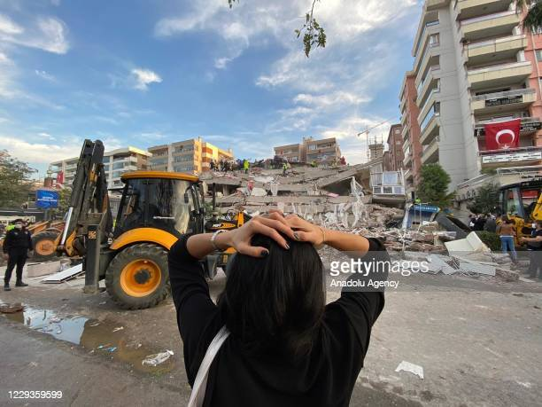 Woman reacts as search and rescue works continue at debris of a building after a quake shook Turkey's Aegean Sea coast, in Izmir, Turkey on October...