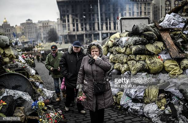 A woman reacts as she arrives at barricades in central Kiev on February 28 2014 Ukraine's parliament on Thursday approved the nomination of proEU...