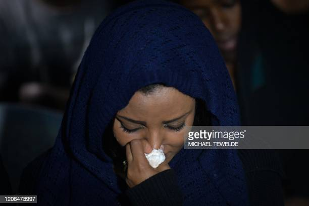TOPSHOT A woman reacts as she attends a commemoration ceremony held by the Airline Pilots' Association of Ethiopia on the first anniversary of the...