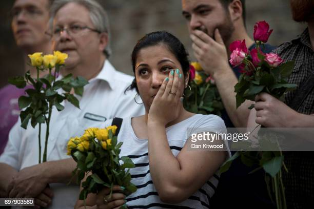 A woman reacts as she attends a vigil near the Finsbury Park Mosque on June 19 2017 in London England Worshippers were struck by a hired van as they...