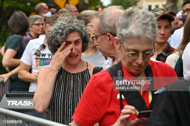 Woman reacts as she gathers with others on Christopher Street outside the Stonewall Inn for a rally to mark the 50th anniversary of the Stonewall...