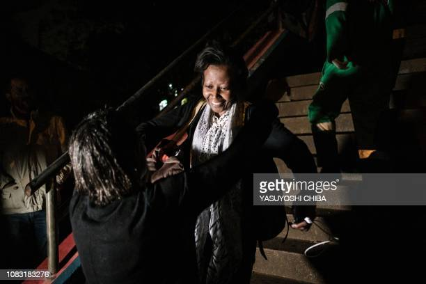 A woman reacts as she is reunited with family after being evacuated from the DusitD2 compound in Nairobi after a blast followed by a gun battle...