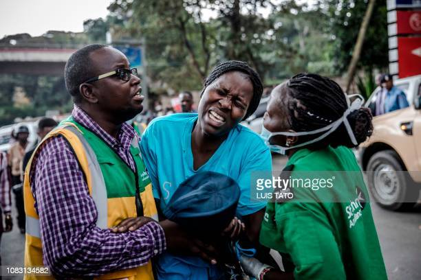 A woman reacts as she leaves the scene of an explosion at a hotel complex in Nairobi's Westlands suburb on January 15 in Kenya The AlShabaab Islamist...