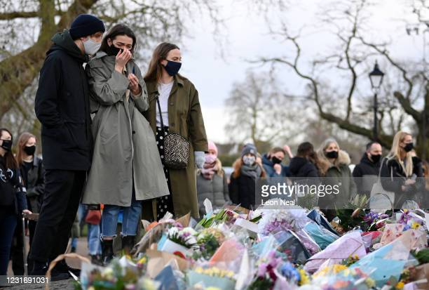 Woman reacts as she looks at tributes for Sarah Everard at the bandstand on Clapham Common on March 13, 2021 in London, United Kingdom. Vigils are...