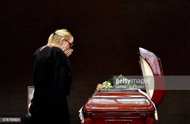 A woman reacts as she pays tribute near the open casket of Belarusborn journalist Pavel Sheremet who was killed in a car bomb in central Kiev on July...
