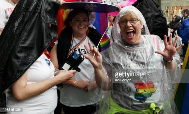 Woman reacts as she takes part in the Newcastle Pride Festival parade on July 20, 2019 in Newcastle upon Tyne, England. To commemorate 50 years since...