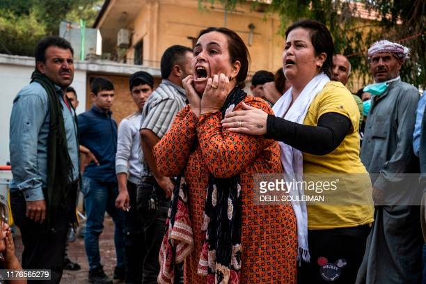 TOPSHOT A woman reacts as the body of a man killed during Turkish shelling in the area surrounding the Syrian Kurdish town of Ras alAin arrives at a...