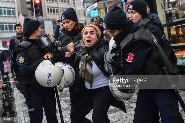TOPSHOT A woman reacts as Turkish antiriot police officers arrest her during a demonstration called by Halklarin Demokratik Partisi members to...