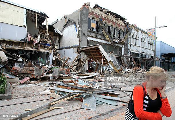 Woman reacts at Cashel Mall in central Christchurch after a 6.3 earthquake on February 22, 2011. The quake, which struck around 1pm local time, was...