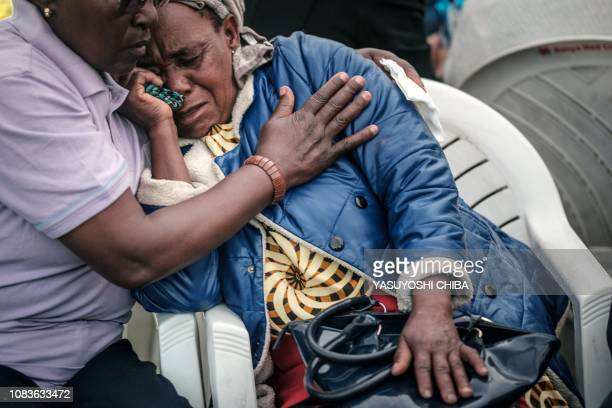 A woman reacts at the Chiromo mortuary where are kept the bodies of the victims of an Islamist attack two days prior at the DusitD2 luxury hotel...