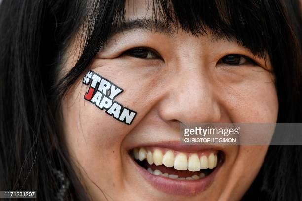 TOPSHOT A woman reacts before the Japan 2019 Rugby World Cup Pool B match between Italy and Canada at the Fukuoka Hakatanomori Stadium in Fukuoka on...