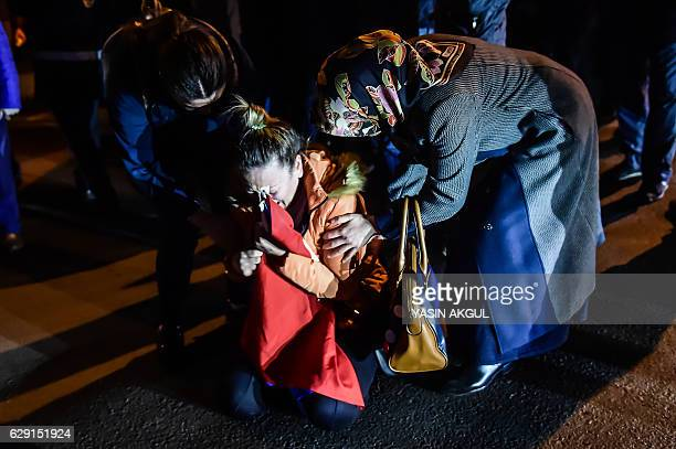 TOPSHOT A woman reacts during a demonstration on December 11 2016 a day after twin bombings near the home stadium of Besiktas football club Turkey...