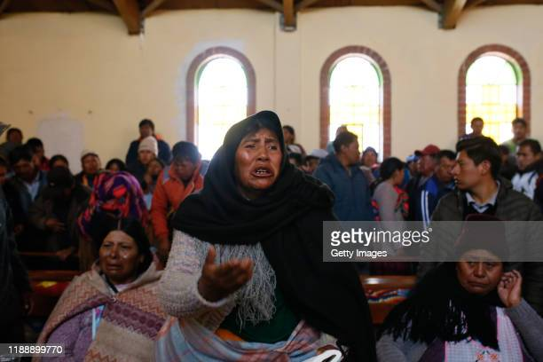 A woman reacts during the funeral of people killed yesterday during clashes between supporters of Evo Morales and security forces in the entrance of...