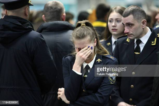Woman reacts during the lying-in-repose ceremony for nine crew members of the Ukraine International Airlines Boeing 737-800 and two passengers killed...