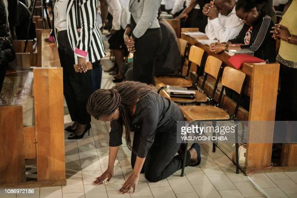 TOPSHOT A woman reacts during the memorial service at the Consolata Shrine in Nairobi Kenya on January 23 2019 for six staff members of the hotel who...