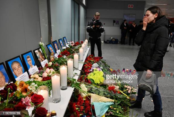 A woman reacts in front of a memorial for the victims of the Ukraine International Airlines Boeing 737800 crash in the Iranian capital Tehran at the...