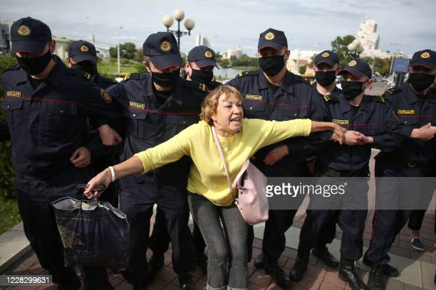 TOPSHOT A woman reacts in front of law enforcement officers as students protest against presidential elections results in Minsk on September 1 2020