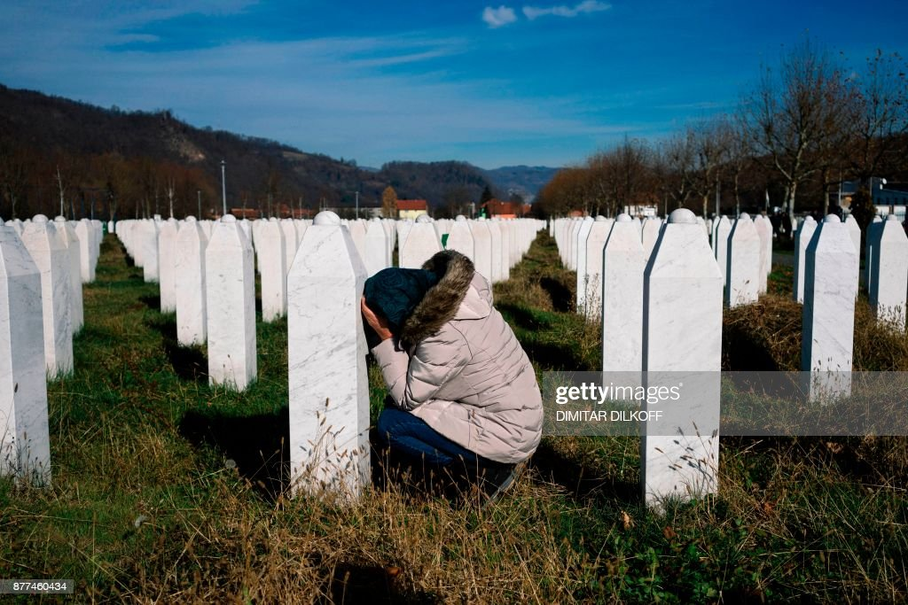 A woman reacts over a relative's grave at the memorial centre of Potocari near Srebrenica on November 22, 2017. United Nations judges on November 22, 2017 sentenced former Bosnian Serbian commander Ratko Mladic to life imprisonment after finding him guilty of genocide and war crimes in the brutal Balkans conflicts over two decades ago. PHOTO / Dimitar DILKOFF