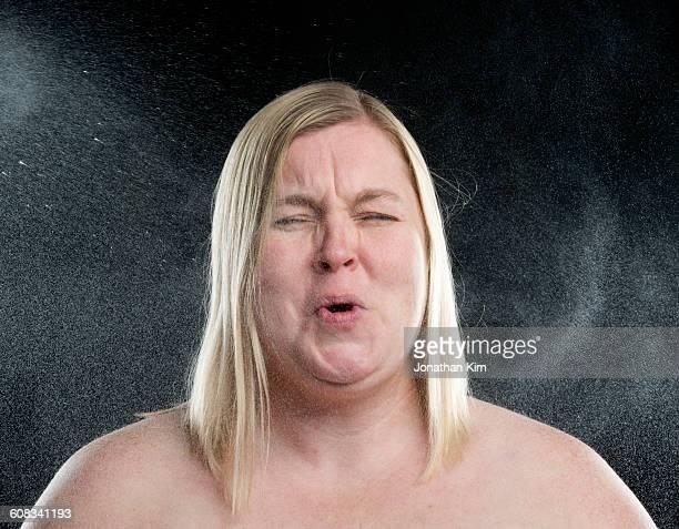 woman reacts to being sprayed with water - oben ohne frau stock-fotos und bilder