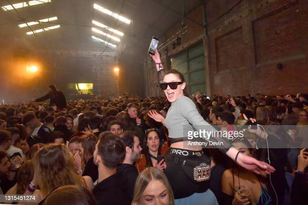 Woman reacts to the camera as Nightclub Circus hosts the first dance event, which will welcome 6,000 clubbers to the city's Bramley-Moore Dock...