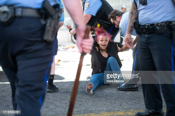 A woman reacts while being arrested during a protest of the death of George Floyd on May 31 2020 in Philadelphia Pennsylvania Protests and looting...