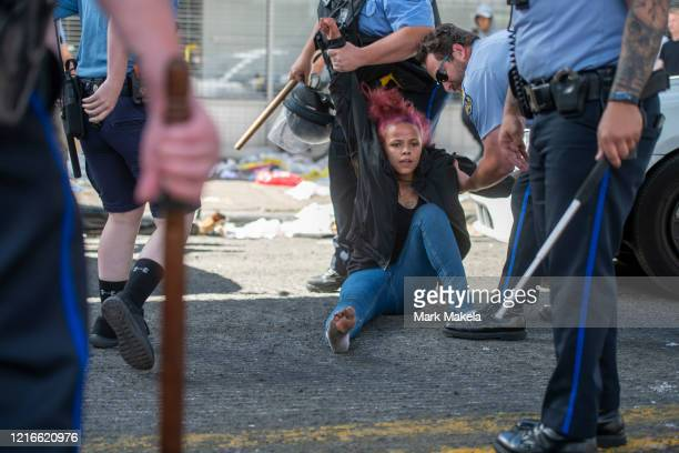 A woman reacts while being arrested during widespread unrest following the death of George Floyd on May 31 2020 in Philadelphia Pennsylvania Protests...